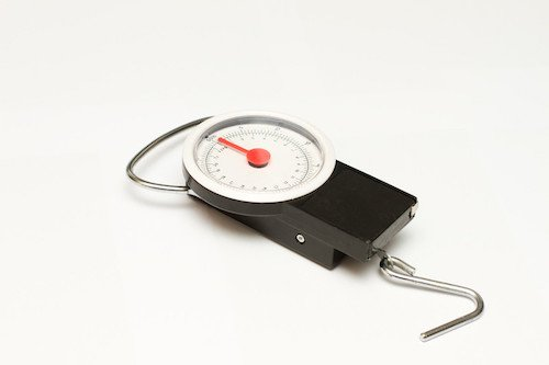 The picture shows a weighing scale than can be used to weigh carry on baggage